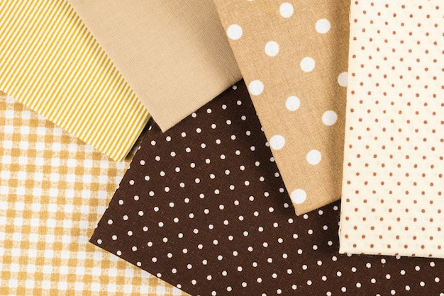 Mix of beige, white and brown cotton fabric.