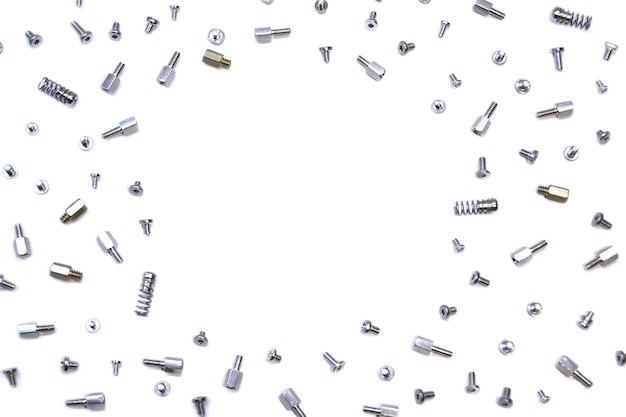 Mix of bolts screws and pins on white background