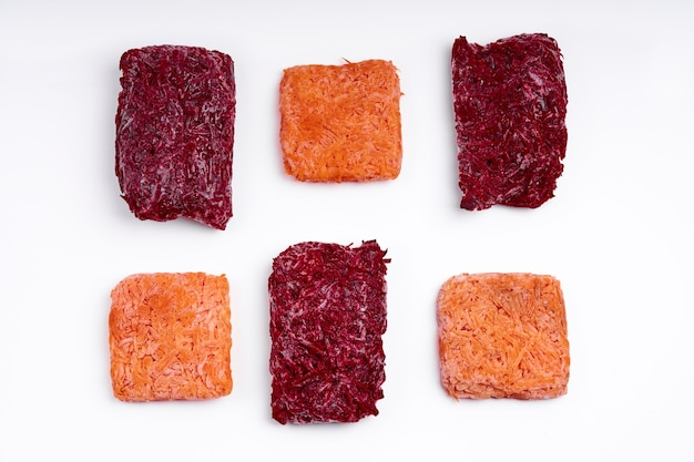 Mix bricks of frozen grated beets and carrots. procurement of frozen food. semifinished.