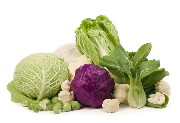 Mix of cabbages on white background: white cabbage, red cabbage