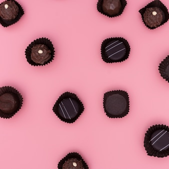 Mix of chocolates on pink background