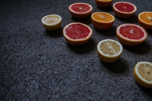 Mix of citrus fruits on concrete background