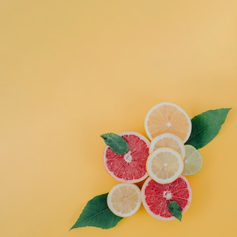 Mix of citrus fruits on table copy-space