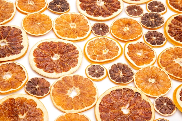 Mix of different pieces of dried citrus fruit on white background