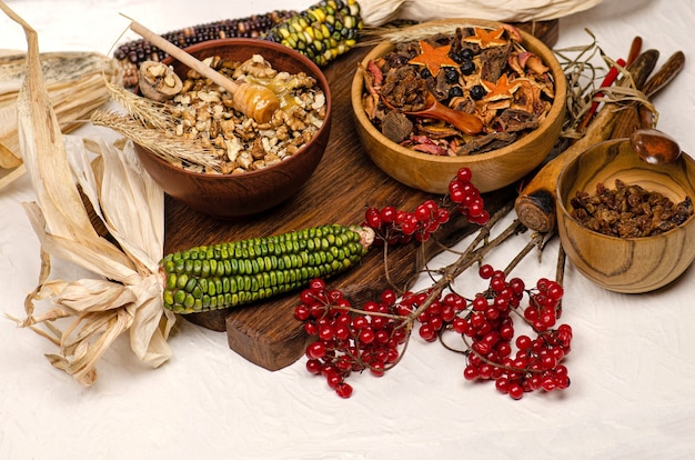 Mix of dried fruits, berries and nuts. dried fruits in wooden bowl. nuts and dried fruits assortment on wood background.