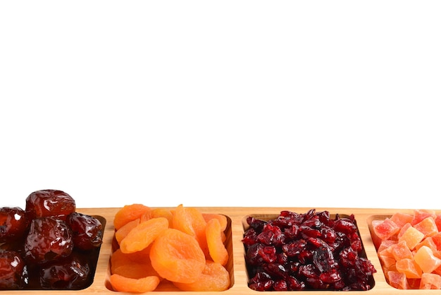Mix of dried fruits and nuts. apricot, raisin, cranberry, dates fruit. isolated on a white wall. space for text or design.