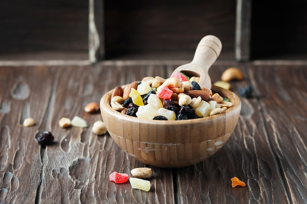 Mix of dried nuts and fruits on the wooden table