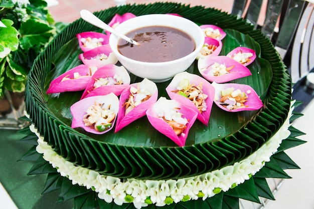 Mix fried rice contained in lotus flower leaf
