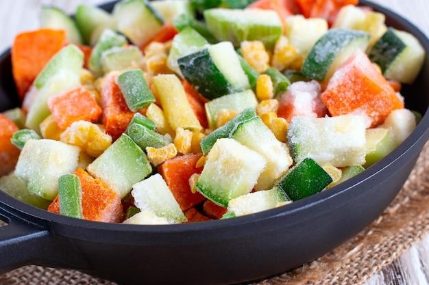 Mix of frozen vegetables in the pan. studio photo