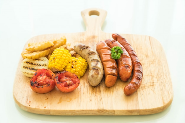 Mix grilled sausage with vegetables and french fries