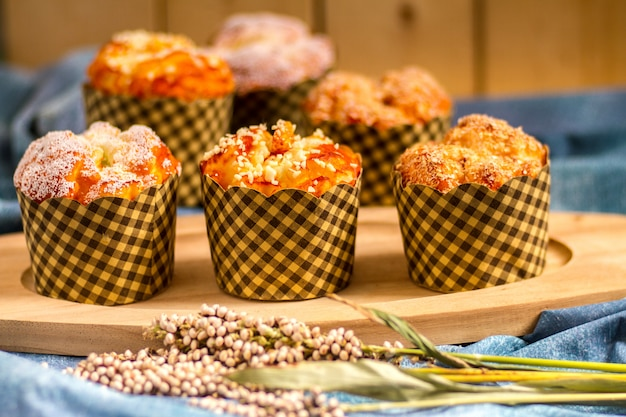 Mix muffins on table with wooden background