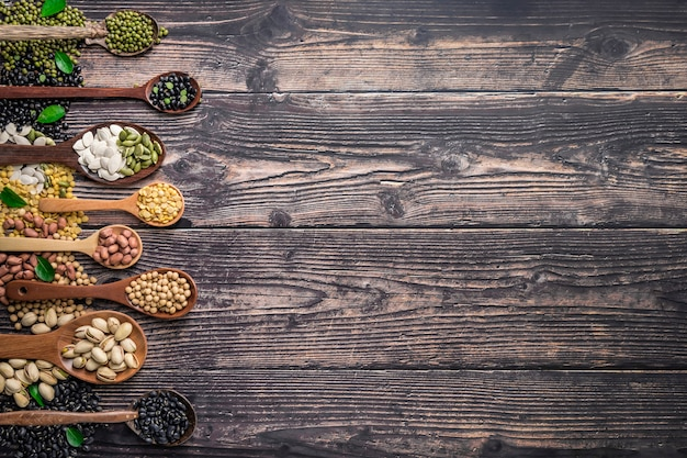 Mix of nuts in wooden spoon with background copyspace