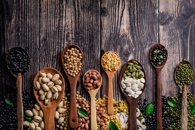 Mix of nuts in wooden spoon.