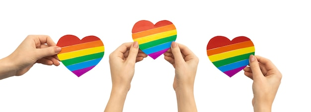 흰색 배경, 배너 디자인, 게이, 레즈비언, 프라이드 월, 컨셉 사진에 격리된 손에 lgbt 무지개 하트 혼합