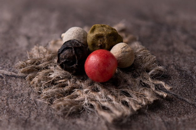 Mix of peppers on jute fabric close-up
