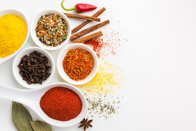 Mix of powder spices on table with copy-space
