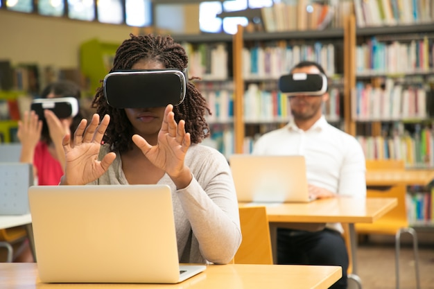 Mix raced group of students using vr experience for studying