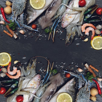 Mix seafood fresh raw seafood with herbs and spices lemon on dark