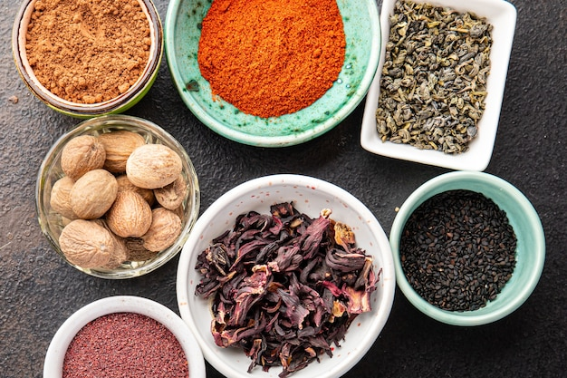 Mix spices seasoning different types pungent and spicy fresh herbs ground spice on the table