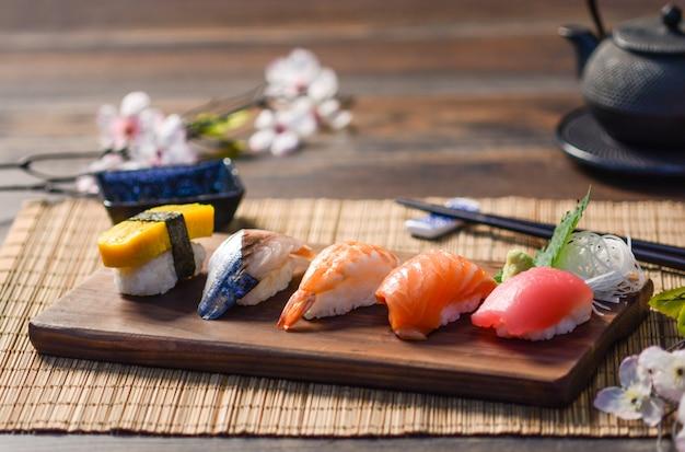 Mix sushi on wood dish, tuna, salmon, sea bass, sweet egg, shrimp sushi, japanese food