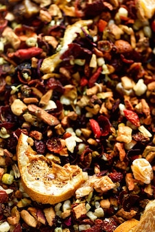Mix tea karkade with dried fruits and flowers. fruit tea and texture. food. organic healthy herbal leaves, detox tea.