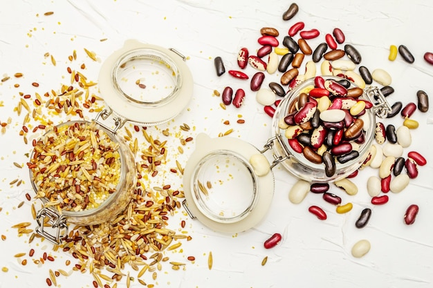 Mix of variety of cereals and beans in glass jars