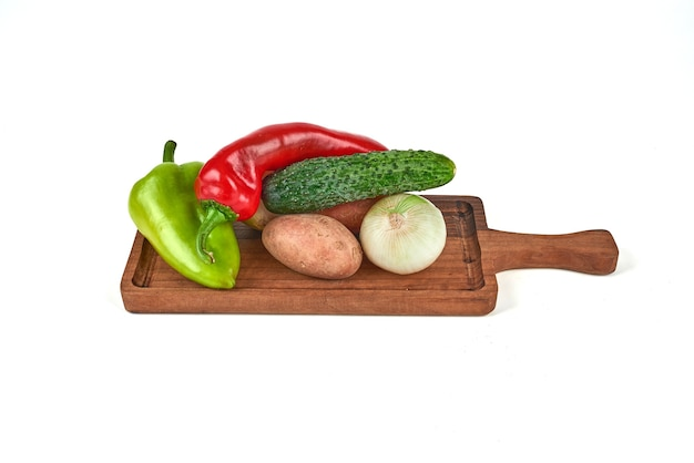Mix of vegetables on a wooden platter.