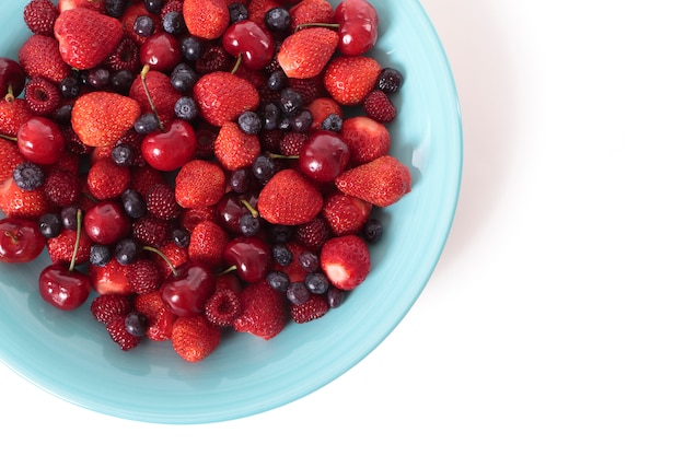 Mixed berries on a blue dish