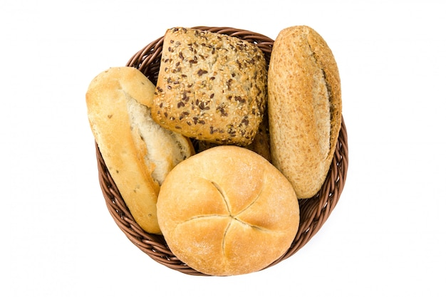 Mixed bread in a basket isolated on white background