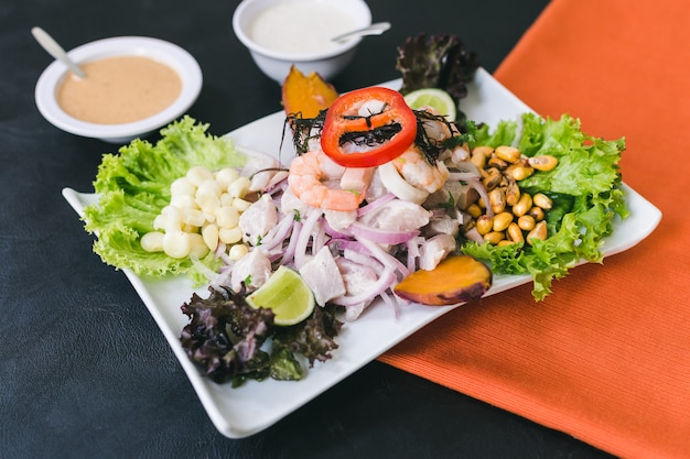 Mixed ceviche with peruvian sauce and garlic sauce