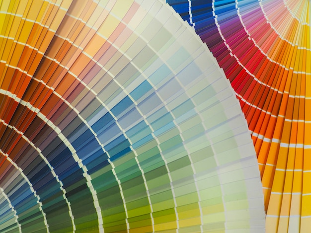 混合色の塗料。装飾的な色付きの背景。