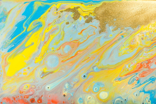 Mixed colored paints background. multicolor burst painting.