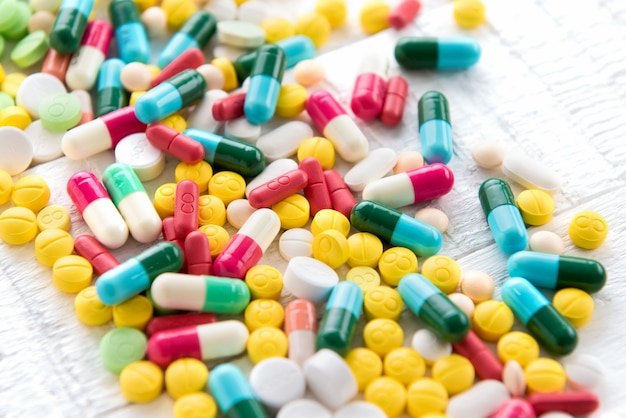 Mixed colorful pharmaceutical drugs and medicine in pill and capsule form