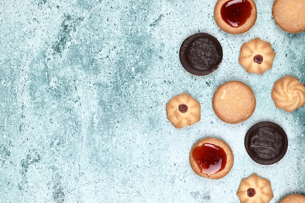 Mixed cookies on a blue background.