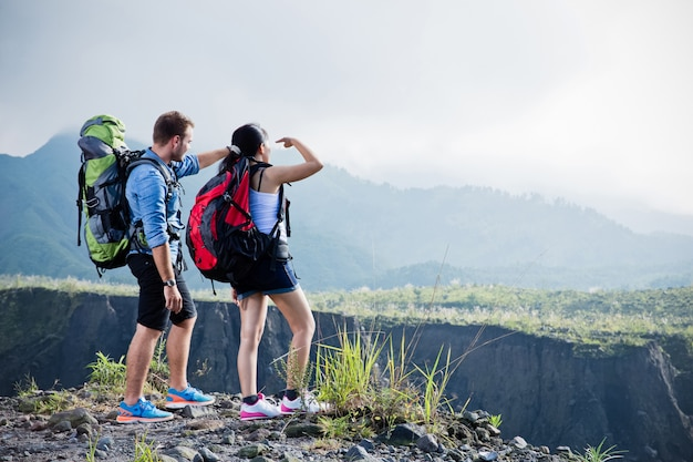Mixed couple go trekking together