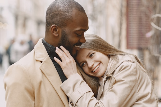 Mixed couple spenting time together in a spring city