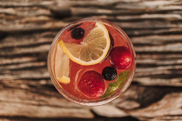 Mixed fruits italian soda for summer refreshment served on table