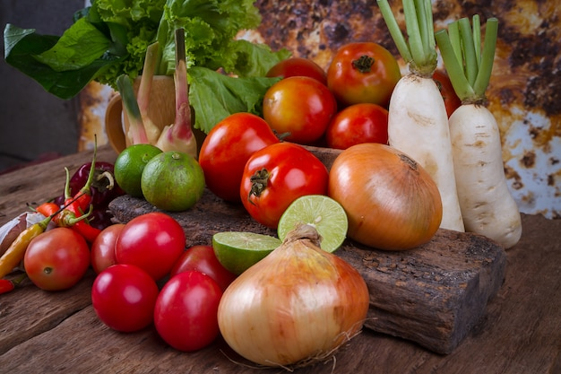 Mixed fruits and vegetables on old wood table
