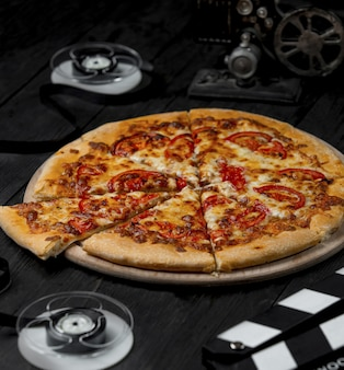 Mixed ingredient pizza cut into slices.