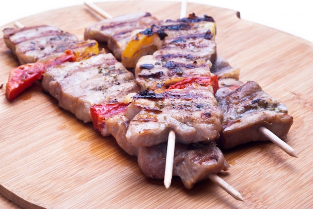 Mixed meat skewer on wooden