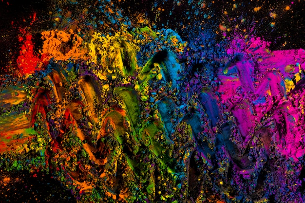 Mixed multicolored dry powder colors on black background