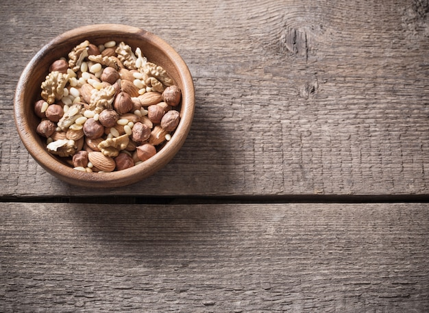 Mixed nuts on old wooden space