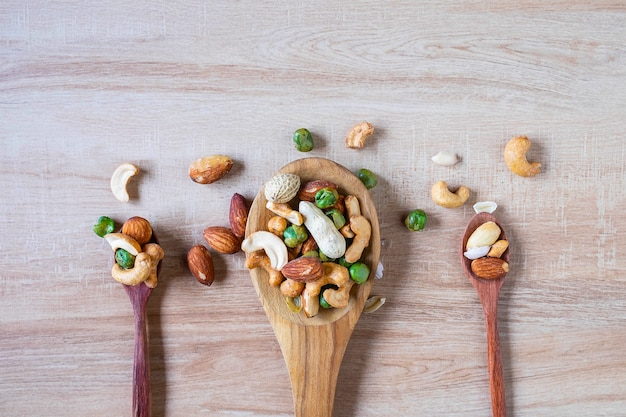 Mixed nuts on a wooden spoon