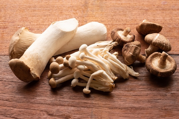 Mixed organic mushrooms on wooden table