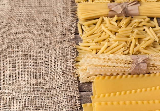 Mixed pasta . on a wooden background. top view