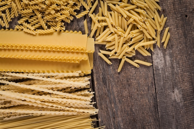 Mixed pasta . on a wooden . top view