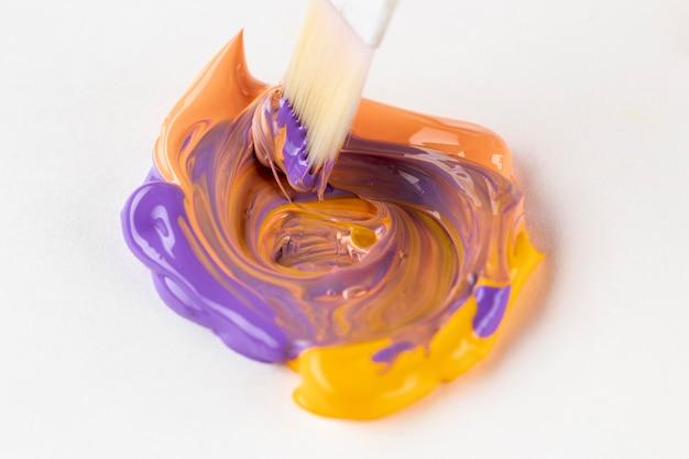 Mixed purple, orange and yellow paint