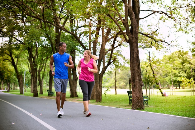 Mixed race couple exercising together in the park