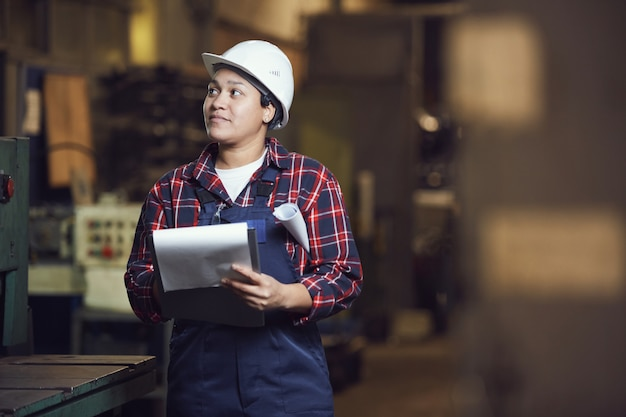 Mixed-race female engineer working at plant