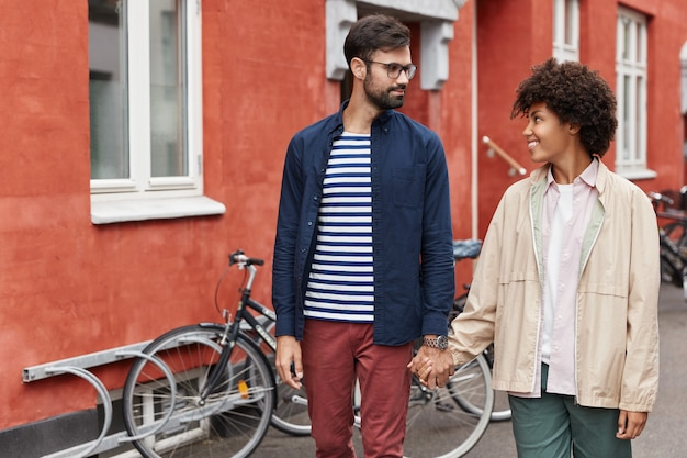 Mixed race lovely young couple have walk outdoor